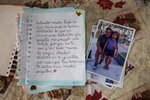 "A letter written by 9-year-old Adriana Wong to her late father Herman Wong, a COVID-19 victim, sits next to a photo showing Adriana when she was 5-years-old with her father, in Iquitos, Peru, Sunday, March 21, 2021. The message on this page of the letter reads in Spanish: ""I miss very much everything we did, the virtual tasks, what you taught me every day, daddy, my heart is sad because I don't see you by my side, I will never forget you, you will live in the family forever, your brothers miss you a lot daddy."" (AP Photo/Rodrigo Abd)"