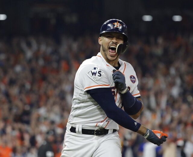 "FILE - In this Oct. 29, 2017, file photo, Houston Astros' Carlos Correa celebrates his two-run home run during the seventh inning of Game 5 of baseball's World Series against the Los Angeles Dodgers in Houston. While the Astros have been punished by Major League Baseball for a sign-stealing scheme in their run to the 2017 championship, and Correa says Houston won that World Series ""fair and square."" (AP Photo/David J. Phillip, File)"