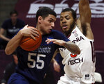 Longwood's Juan Munoz (55) drives against Virginia Tech's Wabissa Bede, right, in the second half of an NCAA college basketball game in Blacksburg, Va., Monday, Dec. 21, 2020. (Matt Gentry/The Roanoke Times via AP, Pool)