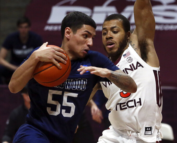 Longwood's Juan Munoz (55) drives against Virginia Tech's Wabissa Bede, right, in the second half of an NCAA college basketball game in Blacksburg, Va., Monday, Dec. 21, 2020. (Matt Gentry/The Roanoke Times via AP, Pool)