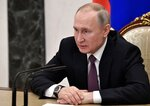 Russian President Vladimir Putin attends a meeting on economic issue in Moscow, Russia, Wednesday, Feb. 12, 2020. (Alexei Nikolsky, Sputnik, Kremlin Pool Photo via AP)
