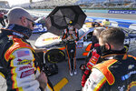 Noah Gragson, center, talks with his crew before the start of a NASCAR Xfinity Series auto race, Saturday, Feb. 27, 2021, in Homestead, Fla. (AP Photo/Wilfredo Lee)