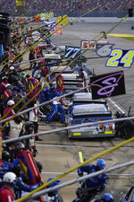 Drivers pit during the NASCAR Cup Series auto race at Talladega Superspeedway on Sunday, Oct. 4, 2020, in Talladega, Ala. (AP Photo/John Bazemore)
