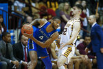 Hampton guard Greg Heckstall, left, runs the offense against Winthrop guard Chandler Vaudrin during the first half of an NCAA college basketball game for the Big South tournament championship in Rock Hill, S.C., Sunday, March 8, 2020. (AP Photo/Nell Redmond)