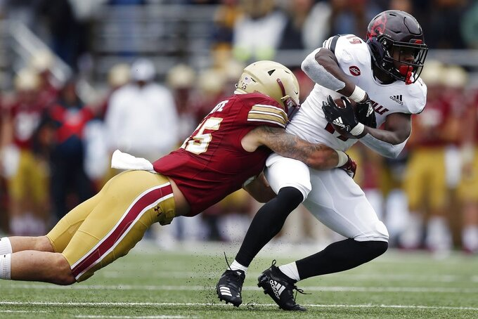 Boston College linebacker Isaiah McDuffie (55) tackles Louisville running back Hassan Hall (19) during the first half of an NCAA college football game in Boston, Saturday, Oct. 13, 2018. (AP Photo/Michael Dwyer)