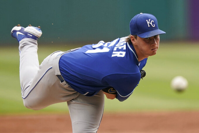 Kansas City Royals starting pitcher Brady Singer delivers in the first inning in the first baseball game of a doubleheader against the Cleveland Indians, Monday, Sept. 20, 2021, in Cleveland. (AP Photo/Tony Dejak)