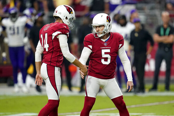 Arizona Cardinals kicker Matt Prater (5) celebrates his go-ahead field goal with punter Andy Lee (14) during the second half of an NFL football game against the Minnesota Vikings, Sunday, Sept. 19, 2021, in Glendale, Ariz. (AP Photo/Ross D. Franklin)