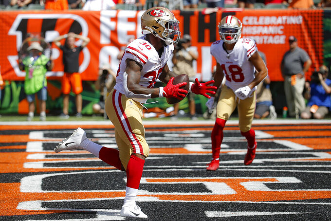 San Francisco 49ers running back Jeffrey Wilson runs in a touchdown during the first half an NFL football game against the Cincinnati Bengals, Sunday, Sept. 15, 2019, in Cincinnati. (AP Photo/Frank Victores)