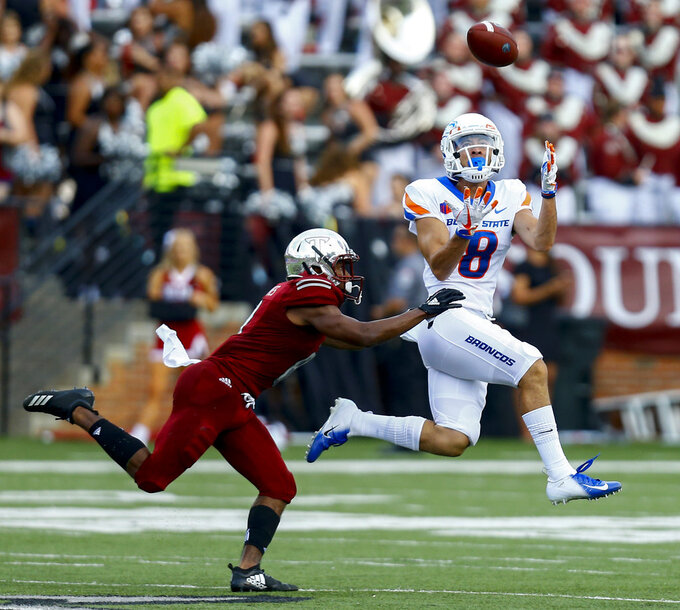 Boise State wide receiver Sean Modster, right, catches a pass as Troy cornerback Marcus Jones, left, tries to defend during the first half of an NCAA college football game, Saturday, Sept. 1, 2018, in Troy, Ala. (AP Photo/Butch Dill)