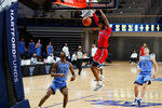 St. John's Vince Cole (15) dunks past Villanova's Trey Patterson (12) during the second half of an NCAA college basketball game, Tuesday, Feb. 23, 2021, in Villanova, Pa. (AP Photo/Matt Slocum)