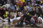 Boston College forward Steffon Mitchell, left, and Louisville guard Lamarr Kimble (0) roll on the floor while competing for the ball during the second half of an NCAA college basketball game in Boston, Wednesday, Jan. 29, 2020. (AP Photo/Charles Krupa)