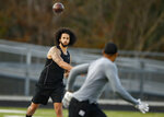 Free agent quarterback Colin Kaepernick participates in a workout for NFL football scouts and media, Saturday, Nov. 16, 2019, in Riverdale, Ga.  Kaepernick is still blackballed from the NFL four years after protesting racial injustice. In the ultimate hypocrisy, the league has taken up the cause that he championed but clearly has no intention of taking Kaepernick back. (AP Photo/Todd Kirkland)