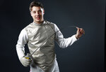 FILE - In this March 9, 2016, file photo, Olympic fencer Alex Massialas poses at the 2016 Team USA Media Summit in Beverly Hills, Calif. If all the athletes from Stanford had been their own country, they would have tied for 11th place in the medal standings at the 2016 Olympics. It's an eye-opening statistic that has been made more jarring because of the recent decision by Stanford to remove nine Olympic sports from its varsity program.  (AP Photo/Damian Dovarganes, File)
