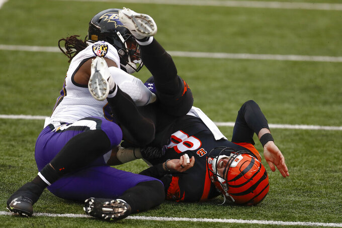 Baltimore Ravens outside linebacker Pernell McPhee (90) tackles Cincinnati Bengals quarterback Brandon Allen (8) during the second half of an NFL football game, Sunday, Jan. 3, 2021, in Cincinnati. (AP Photo/Aaron Doster)