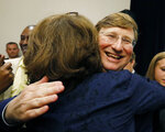 Lt. Gov. Tate Reeves hugs a supporter shortly after being declared winner of the runoff election for the Republican nomination for governor in Jackson, Miss., Tuesday evening, Aug. 27, 2019. Reeves beat former Mississippi Supreme Court Chief Justice Bill Waller Jr. in the runoff. (AP Photo/Rogelio V. Solis)