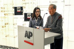 Rao Jian, right, son of Y.C. Jao, speaks during a ceremony at the Associated Press headquarters, in New York, Wednesday, Dec. 11, 2019, honoring Jao for his service as a Chinese correspondent working for the AP in China at the time of the Communist Red Army's victory over Nationalist forces and its conquest of China. Jao continued to work for AP in Nanjing even after American correspondents were evicted from the country. His passion for journalism led to his execution in 1951. (AP Photo/ Chuck Zoeller)
