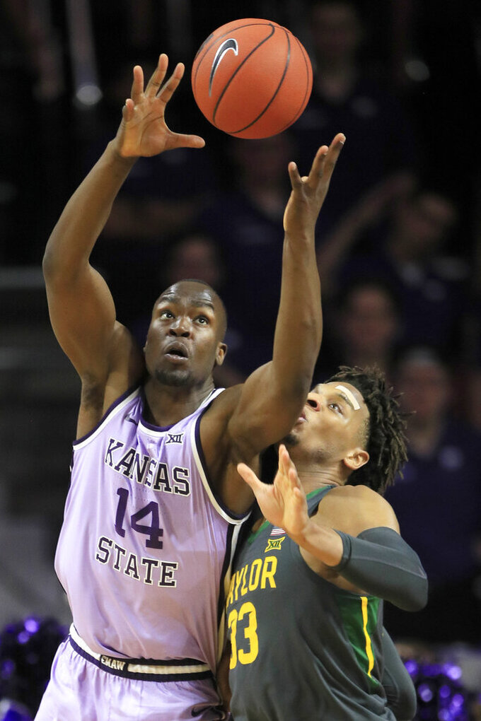 Kansas State forward Makol Mawien (14) rebounds against Baylor forward Freddie Gillespie (33) during the first half of an NCAA college basketball game in Manhattan, Kan., Monday, Feb. 3, 2020. (AP Photo/Orlin Wagner)