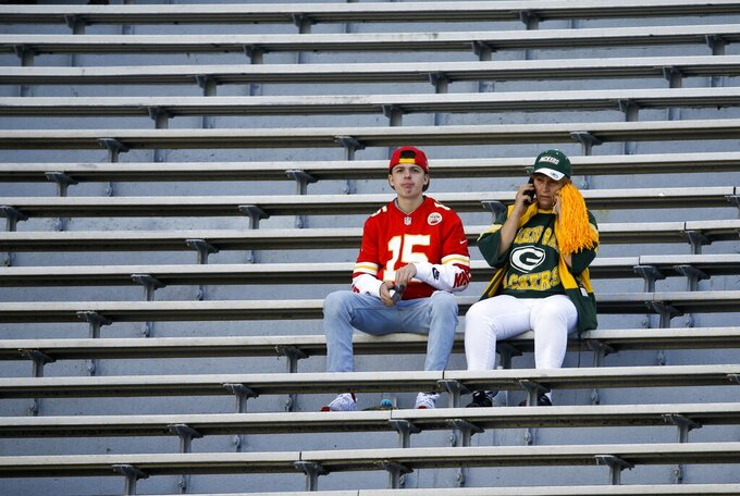 Fans wait for the start of a preseason NFL football game between the Green Bay Packers and the Kansas City Chiefs Thursday, Aug. 29, 2019, in Green Bay, Wis. (AP Photo/Mike Roemer)