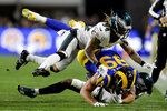 FILE - In this Dec. 16, 2018, file photo, Los Angeles Rams tight end Tyler Higbee is tackled by Philadelphia Eagles cornerback Cre'von LeBlanc, top, and cornerback Rasul Douglas during the first half in an NFL football game, in Los Angeles. When injuries ravaged the secondary, the Eagles turned to inexperienced guys and castoffs. The no-names are making themselves known. (AP Photo/Marcio Jose Sanchez, File)