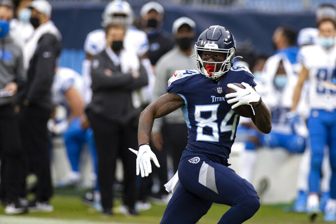 FILE - In this Sunday, Dec. 20, 2020, file photo, Tennessee Titans wide receiver Corey Davis (84) runs with a touchdown reception against the Detroit Lions during the first quarter of an NFL football game, in Nashville, Tenn. On Monday, March 15, 2021, the Jets agreed to a deal  with former Tennessee Titans wide receiver Corey Davis. (AP Photo/Brett Carlsen, File)
