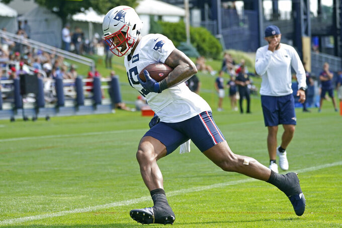 New England Patriots wide receiver N'Keal Harry (15) runs after catching a pass during an NFL football practice, Friday, July 30, 2021, in Foxborough, Mass. (AP Photo/Elise Amendola)