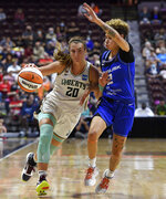 5/28/21 :: SPORTS :: GRIFFEN :: New York Liberty guard Sabrina Ionescu (20) drives into the defense of Connecticut Sun guard Natisha Hiedeman (2) in WNBA action Wednesday, September 15, 2021 at Mohegan Sun Arena in Uncasville, Conn. (Sean D. Elliot/The Day via AP)