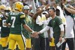 Green Bay Packers head coach Matt LaFleur congratulates Kurt Benkert (7) after a touchdown pass during the first half of a preseason NFL football game against the New York Jets Saturday, Aug. 21, 2021, in Green Bay, Wis. (AP Photo/Mike Roemer)