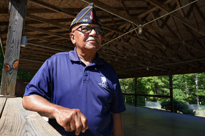 Army veteran Willie Ransom poses at the American Legion Lodge named after his son, Air Force Major Charles Ransom in Midlothian, Va., Thursday, May 27, 2021. The younger Ransom was among eight U.S. Airmen killed when an Afghan military pilot opened fire at the Kabul airport in 2011. (AP Photo/Steve Helber)