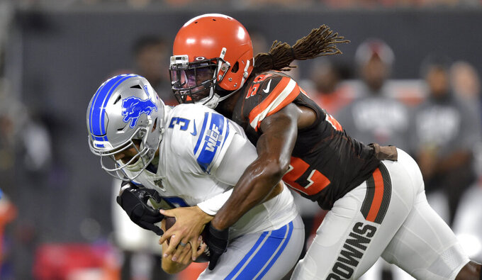 Cleveland Browns linebacker Ray-Ray Armstrong (52) sacks Detroit Lions quarterback Tom Savage (3) during the first half of an NFL preseason football game, Thursday, Aug. 29, 2019, in Cleveland. (AP Photo/David Richard)