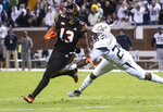 Miami running back DeeJay Dallas (13) rushes as Georgia Tech defensive back Tariq Carpenter reaches to stop him during the first half of an NCAA college football game Saturday, Nov. 10, 2018, in Atlanta. (AP Photo/John Amis)