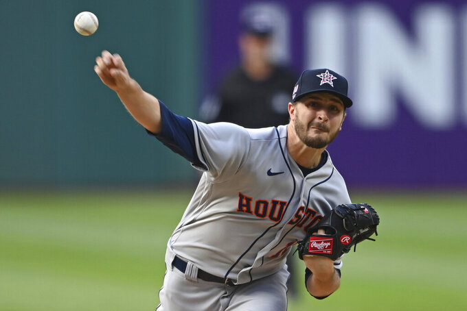 Houston Astros starting pitcher Jake Odorizzi delivers in the first inning of a baseball game against the Cleveland Indians, July 3, 2021, in Cleveland. (AP Photo/David Dermer)
