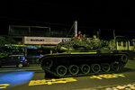 In this photo released by the Military News Agency, a tank prepares to take part in the annual Han Kuang live-fire drills in Hualian, eastern Taiwan in the early hours of Tuesday, Sept. 14, 2021. (Military News Agency via AP)