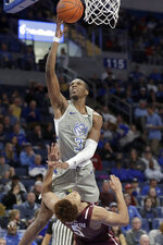 Saint Louis' Javonte Perkins (3) heads to the basket as Fordham's Chris Austin (5) defends during the second half of an NCAA college basketball game Sunday, Jan. 26, 2020, in St. Louis. (AP Photo/Jeff Roberson)