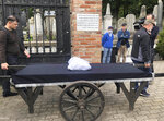 """Warsaw's Jewish community hold a funeral for an unidentified Holocaust victim after human remains were recently discovered in an area that belonged to the Warsaw Ghetto during World War II, in Warsaw, Poland, Tuesday Sept. 14, 2021. The remains were buried in Warsaw's Jewish Cemetery, with the country's chief rabbi saying, """"We are here as the family for a person we don't know."""" (AP Photo/Vanessa Gera)"""