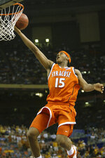 FILE - In this April 5, 2003, file photo, Syracuse's Carmelo Anthony puts up a layup in the closing seconds of the Orangemen's 95-84 win over Texas in the semifinals of the Final Four in New Orleans. Anthony averaged 26.5 points and 12 rebounds per game in the 2003 Final Four. The only first-year players ever to be named the most outstanding player of a Final Four are Anthony Davis, Carmelo Anthony and Duke's Tyus Jones in 2015. (AP Photo/Michael Conroy, File)