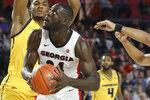 Georgia forward Derek Ogbeide (34) looks for a shot against Kennesaw State during an NCAA college basketball game in Athens, Ga., Tuesday, Nov. 27, 2018. (Jenn Finch/Athens Banner-Herald via AP)