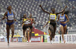 Halimah Nakaayi, of Uganda celebrates as she wins the gold medal in the women's 800m final ahead of Raevyn Rogers, of the United States, at the World Athletics Championships in Doha, Qatar, Monday, Sept. 30, 2019. (AP Photo/Petr David Josek)
