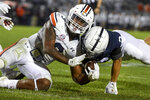 Auburn linebacker Zakoby McClain (9) hits Penn State wide receiver Parker Washington (3) during the fourth quarter of their NCAA college football game in State College, Pa., on Saturday, Sept. 18, 2021. McClain was called for targeting. Penn State won 28-20. (AP Photo/Barry Reeger)