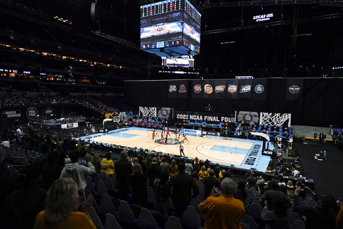 Players get set for the opening tipoff at the start of a men's Final Four NCAA college basketball tournament semifinal game between Baylor and Houston, Saturday, April 3, 2021, at Lucas Oil Stadium in Indianapolis. (AP Photo/Darron Cummings)