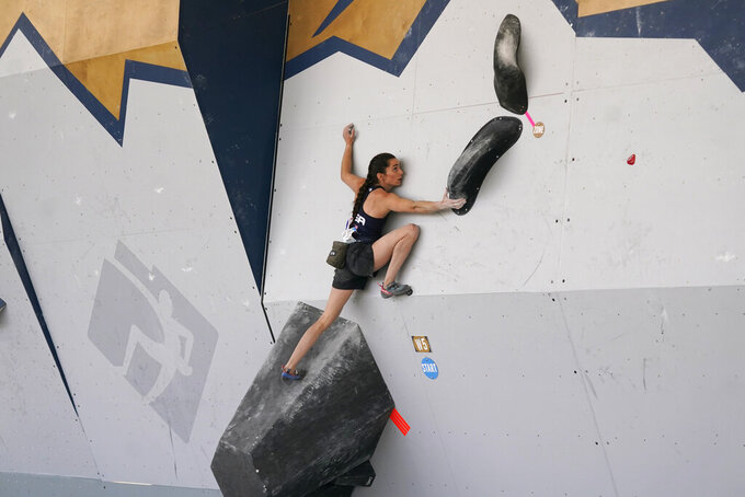 FILE - United States' Kyra Condie climbs during women's boulder qualifications at the climbing World Cup in Salt Lake City, in this May 21, 2021, file photo. Condie was told she needed back surgery to fix a severe curvature in her spine and would never be able to climb again. She did have surgery, after getting a second opinion, and has willed herself into becoming one of the world's elite climbers despite having 10 vertebrae fused together. (AP Photo/Rick Bowmer, File)