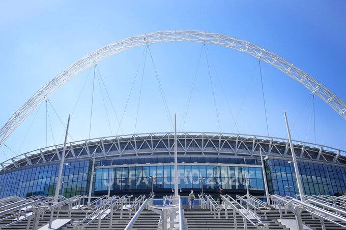 FILE - In this Wednesday, June 9, 2021 file photo, a view of the entrance to Wembley stadium, ahead of the  Euro 2020 soccer championship in London. The British government says more than 60,000 fans will be allowed into the semifinals and final of the European Championship at Wembley Stadium. No details have been provided yet on how fans from overseas can attend without having to quarantine after flying into London. (AP Photo/Frank Augstein, File)