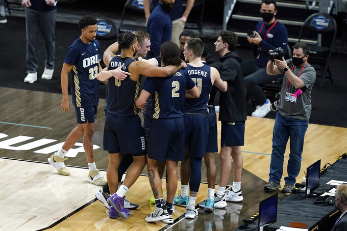 Oral Roberts players react after a Sweet 16 game against Arkansas in the NCAA men's college basketball tournament at Bankers Life Fieldhouse, Saturday, March 27, 2021, in Indianapolis. Arkansas won 72-70. (AP Photo/Darron Cummings)