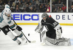 San Jose Sharks center Melker Karlsson, left, tries to get a shot past Los Angeles Kings goaltender Jonathan Quick during the third period of an NHL hockey game Thursday, March 21, 2019, in Los Angeles. The Kings won 4-2. (AP Photo/Mark J. Terrill)