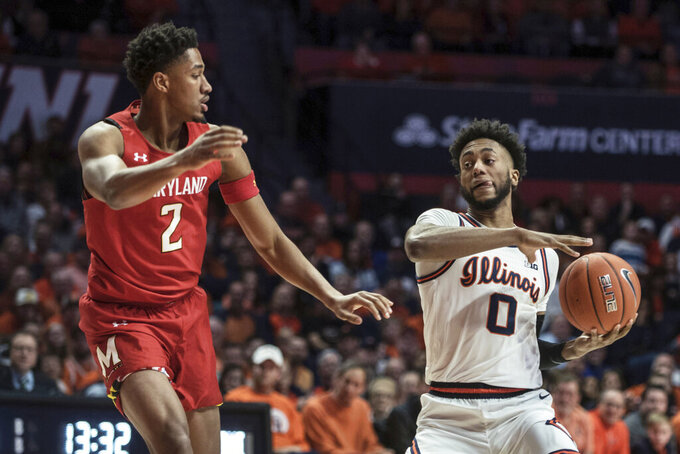 Illinois' Alan Griffin (0) looks to pass the ball as Maryland's Aaron Wiggins (2) defends during the first half of an NCAA college basketball game Friday, Feb. 7, 2020, in Champaign, Ill. (AP Photo/Holly Hart)