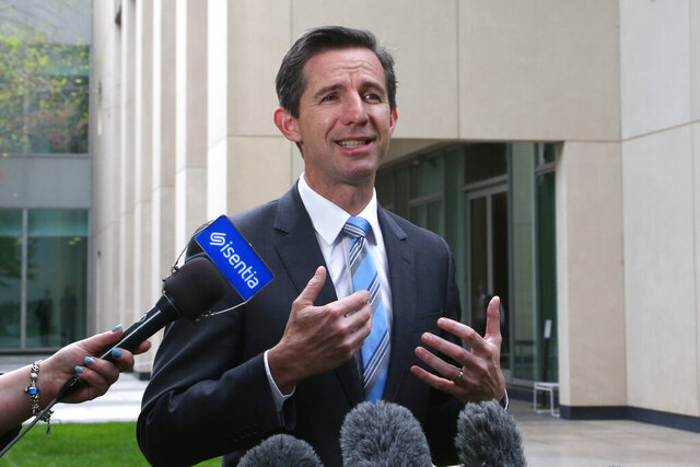 FILE- In this Oct. 16, 2019, file photo, Australia's Trade Minister Simon Birmingham addresses media outside the Parliament House in Canberra, Australia. Australia will ask the World Trade Organization to intervene in its dispute with China over barley and expects other nations to become involved in the case, Australian Trade Minister Birmingham said on Wednesday, Dec. 16, 2020. (AP Photo/Rod McGuirk, File)