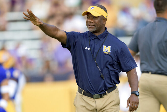McNeese State head coach Frank Wilson waves before the team's NCAA college football game against LSU in Baton Rouge, La., Saturday, Sept. 11, 2021. (AP Photo/Matthew Hinton)