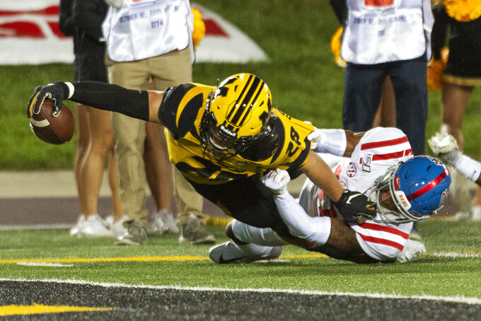 Missouri running back Dawson Downing, left, reaches the ball across the goal line to score a touchdown as Mississippi defensive back Jaylon Jones, right, tries to stop him during the third quarter of an NCAA college football game Saturday, Oct. 12, 2019, in Columbia, Mo. (AP Photo/L.G. Patterson)
