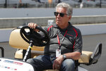 FILE - In this Saturday, May 18, 2019 file photo, 1969 Indianapolis 500 champion Mario Andretti sits in his golf cart during qualifications for the Indianapolis 500 IndyCar auto race at Indianapolis Motor Speedway in Indianapolis. Mario Andretti sees the reminders of 1969 everywhere he turns these days. His face, his race-car number, even that familiar STP logo appear on an endless array of memorabilia at this year's Indianapolis 500. He has own street, his own badge and even his own store. It's all part of the golden anniversary of the first and only 500 win for one of the greatest drivers in racing history. (AP Photo/Michael Conroy, File)
