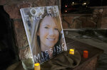 FILE - This Dec. 13, 2018 file photo shows a poster with a photo of missing Kelsey Berreth, surrounded by candles during a vigil at Memorial Park in Woodland Park, Colo. Krystal Lee, who was having an affair with a Colorado man and helped him after he beat his fiancee to death with a baseball bat, was sentenced Tuesday, Jan. 28, 2020, to three years in prison. (Kelsey Brunner/The Gazette via AP, File)