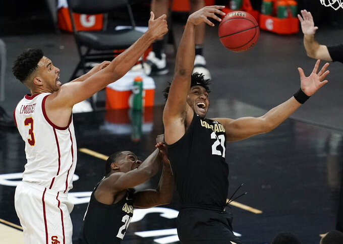 Colorado's Evan Battey, right, and Southern California's Isaiah Mobley (3) battle for a rebound during the first half of an NCAA college basketball game in the semifinal round of the Pac-12 men's tournament Friday, March 12, 2021, in Las Vegas. (AP Photo/John Locher)